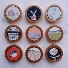 custom framed mini circle oil paintings by artist katrina berg of the candy colored studio