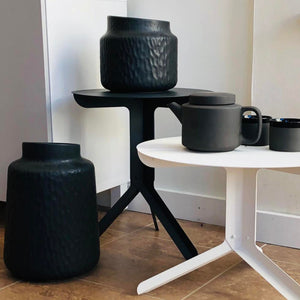 Bokk Bar Stool with modern furniture in the background.