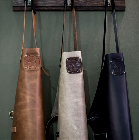 Three leather aprons