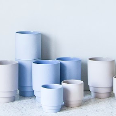 stacks of colorful blue mugs