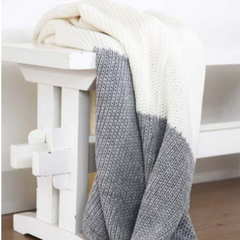 white and gray knit thrown