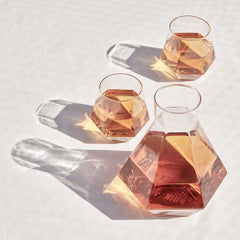 geometric drinking glasses and decanter sparking in light