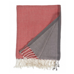gray and coral woven throw