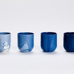 set of four mugs in shades of blue
