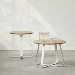 side table with wooden round top and metal white cross cross base