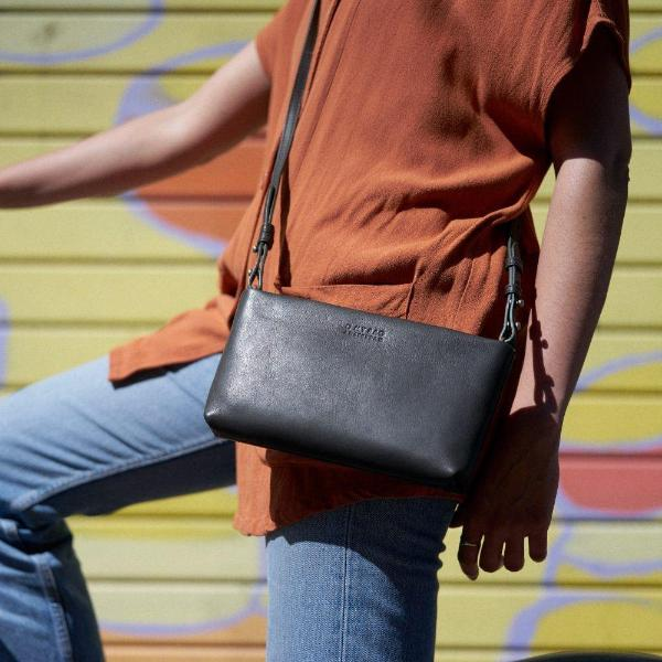 The Dashing Daisy Eco Midnight Black Bag by O My Bag on a model.