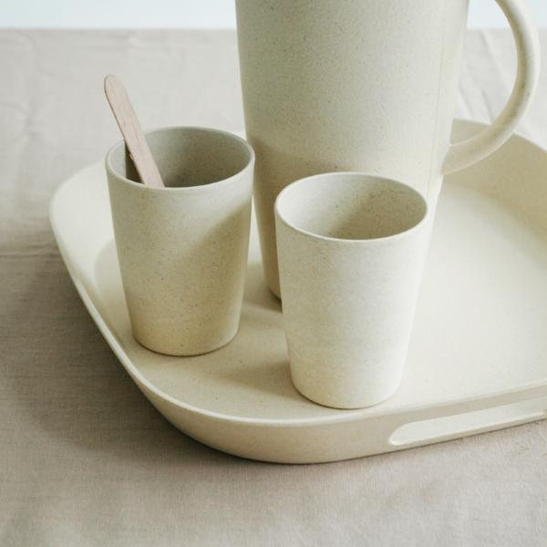 The Zuperzozial Foursquare serving tray in white holding two cups and a pitcher.