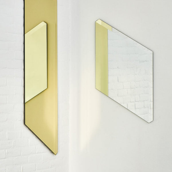 Facett Mirrors by Puik reflecting light off of each other.