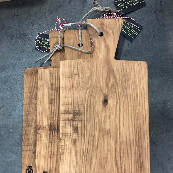 A stack of Mare Cutting Boards by Brood + Plank.
