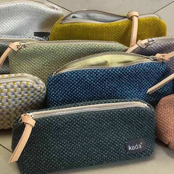 All different colors of KODA's small triangle accessory pouch.