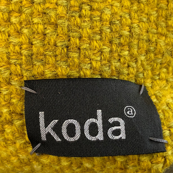 Closeup of the yellow small triangle accessory pouch by KODA.