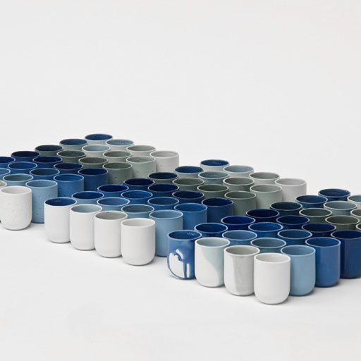 Rows of gradient mugs by De Intuitiefabriek in whites, greys, blues, and greens.