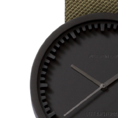 Closeup of black and green Tube Watch D Series by Leff Amsterdam.