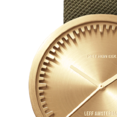 Closeup of brass and green Tube Watch D Series by Leff Amsterdam.