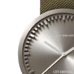 Closeup of steel and green Tube Watch D Series by Leff Amsterdam.