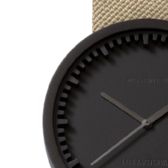 Closeup of black and sand Tube Watch D Series by Leff Amsterdam.