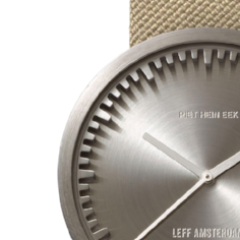 Closeup of steel and sand Tube Watch D Series by Leff Amsterdam.