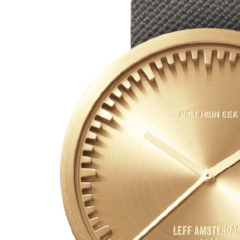 Closeup of brass and grey Tube Watch D Series by Leff Amsterdam.