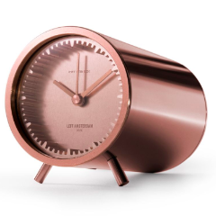 Full body view of the copper tube clock by LEFF Amsterdam.