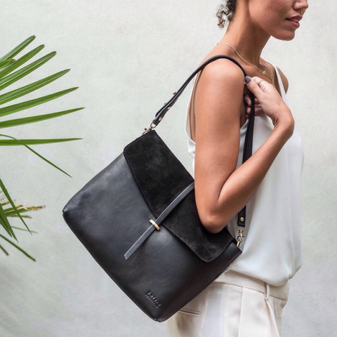 Midnight Black Ella Bag by O My Bag. Modeled by a woman against a blank wall.
