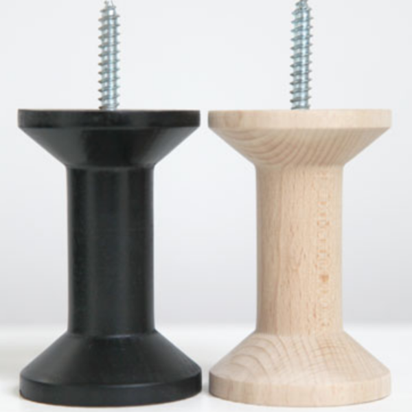 Two Haak Wall Hooks by ONSHUS in black and natural. Hooks are standing on their base.