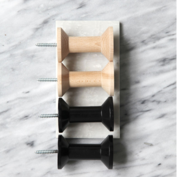 Four Haak Wall Hooks by ONSHUS in natural and black.