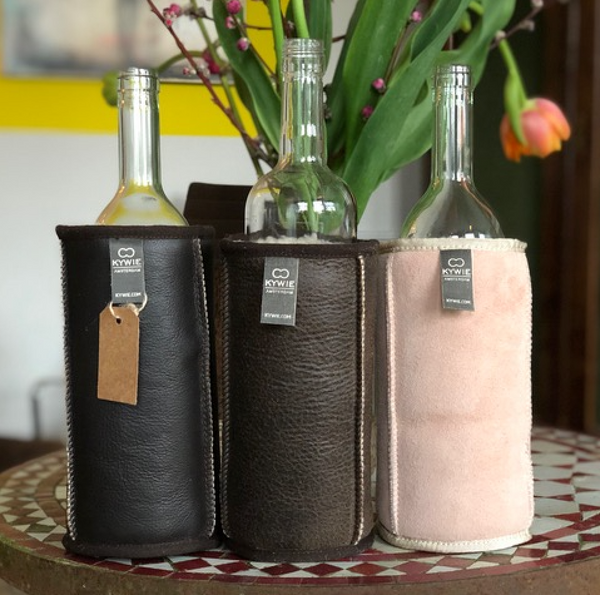 set of three sheepskin wine coolers black brown and pink