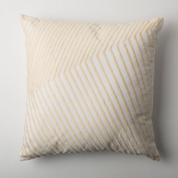 The Arrabida cushion by Urban Nature Culture in Sand. A square cushion with embroidery against a white background.