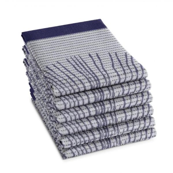 A stack of Osaka Tea Towels in indigo by DDDDD.