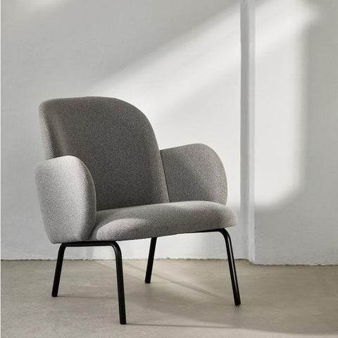 Dark Grey Dost Chair in an empty room.