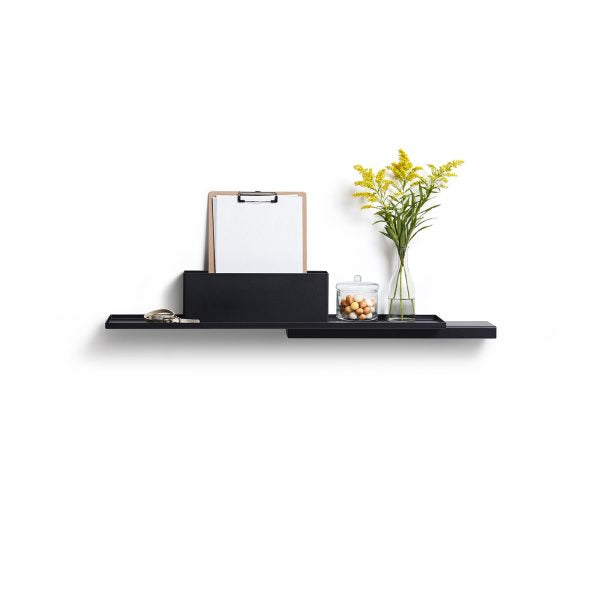 Black Duplex Shelf by Puik against a white background. Decorated with plants and a clipboard.