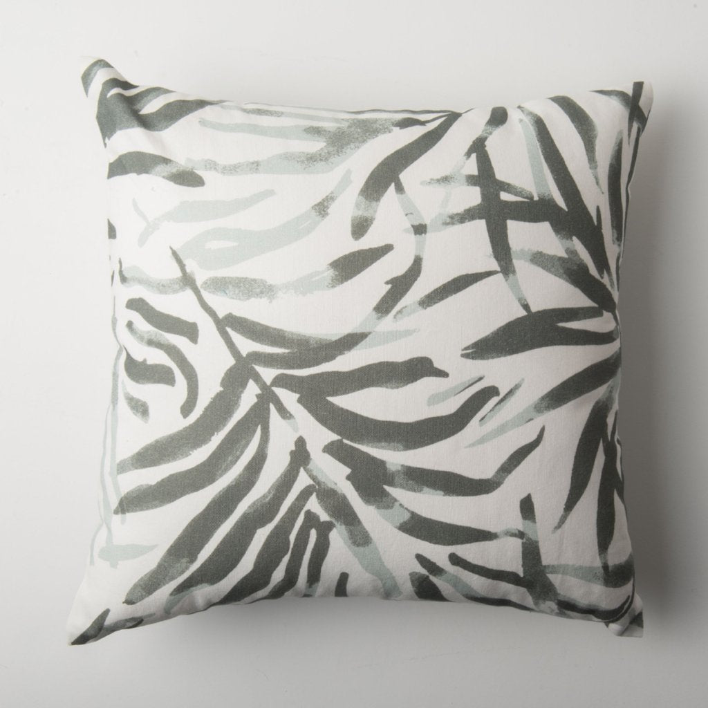 The Flor Verde Cushion by Urban Nature Culture. Off-white background with a muted green gray leaf print.