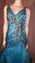 Aqua, long dress, sleeveless, zoomed in front view, rhinestone design, ruffled bottom, corset in back