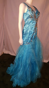 Aqua, long dress, sleeveless,  side view, rhinestone design, ruffled bottom, corset in back