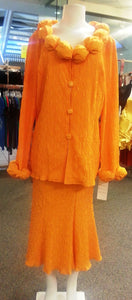 Orange 2 pices dress, front view,  long sleeves, button blouse, below the knee skirt
