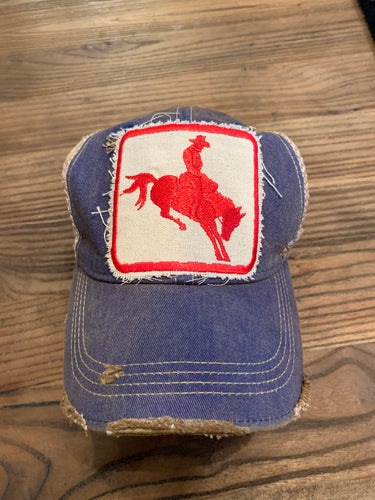 Red Cowboy on vintage blue distressed hat