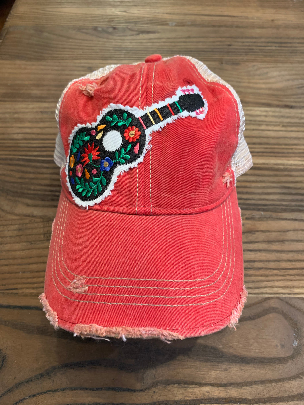 Floral guitar on vintage red hat