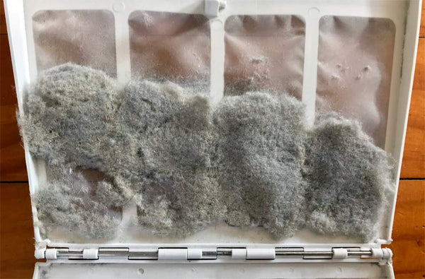Clean out dryer filter of wool dust regularly