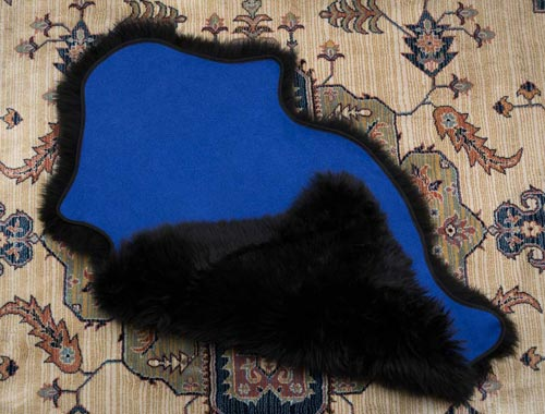 Black sheepskin with bright blue fabric lining