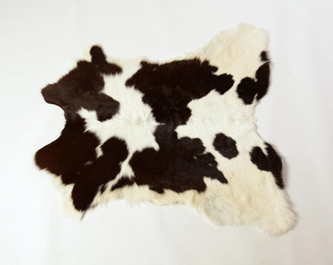 Warm black and white calfskin rug