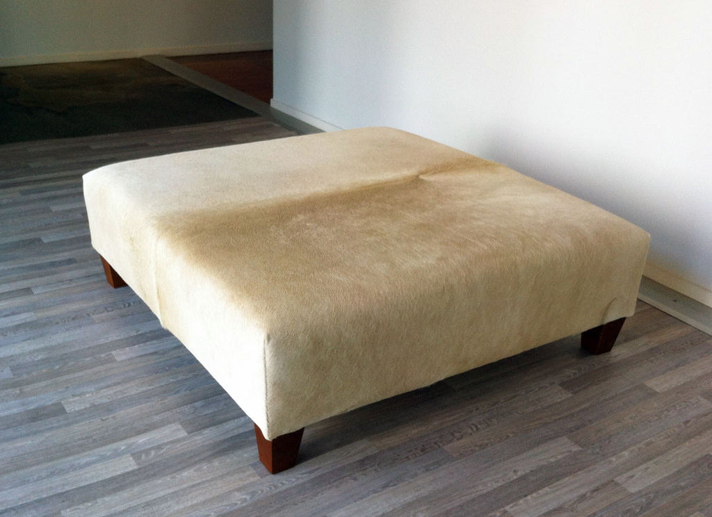 Beige Cowhide Ottoman with Low Square Wood Legs 115x115x38cm
