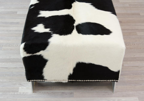 Image of Cowhide Ottoman with Metal Studs and Kyle Legs 110x60x42cm