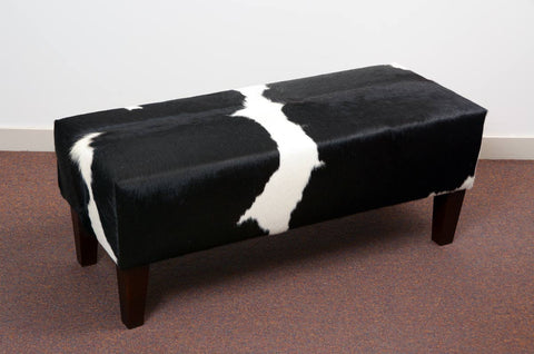 Gorgeous Creatures black & white cowhide bench seat ottoman