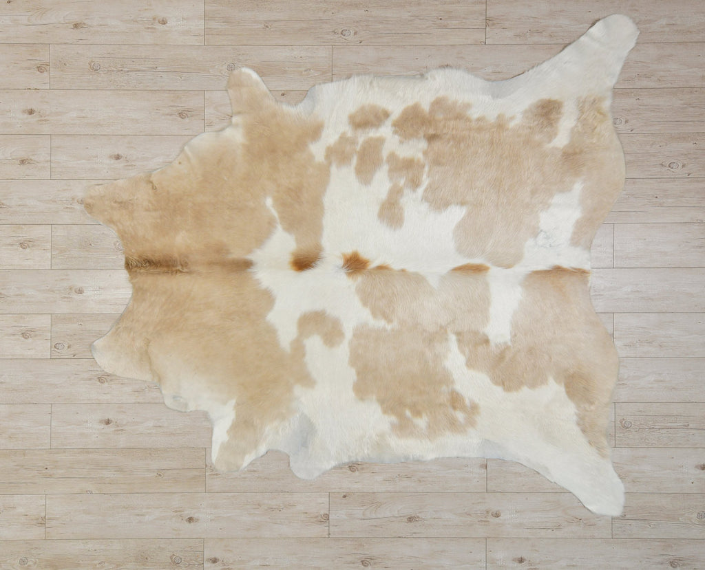 Gorgeous beige & white cowhide rug