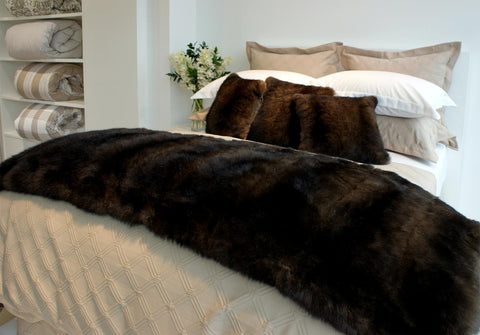 Chocolate brown possum fur bed footer throw