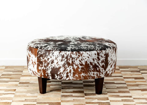 Image of Speckled round cowhide ottoman with square legs