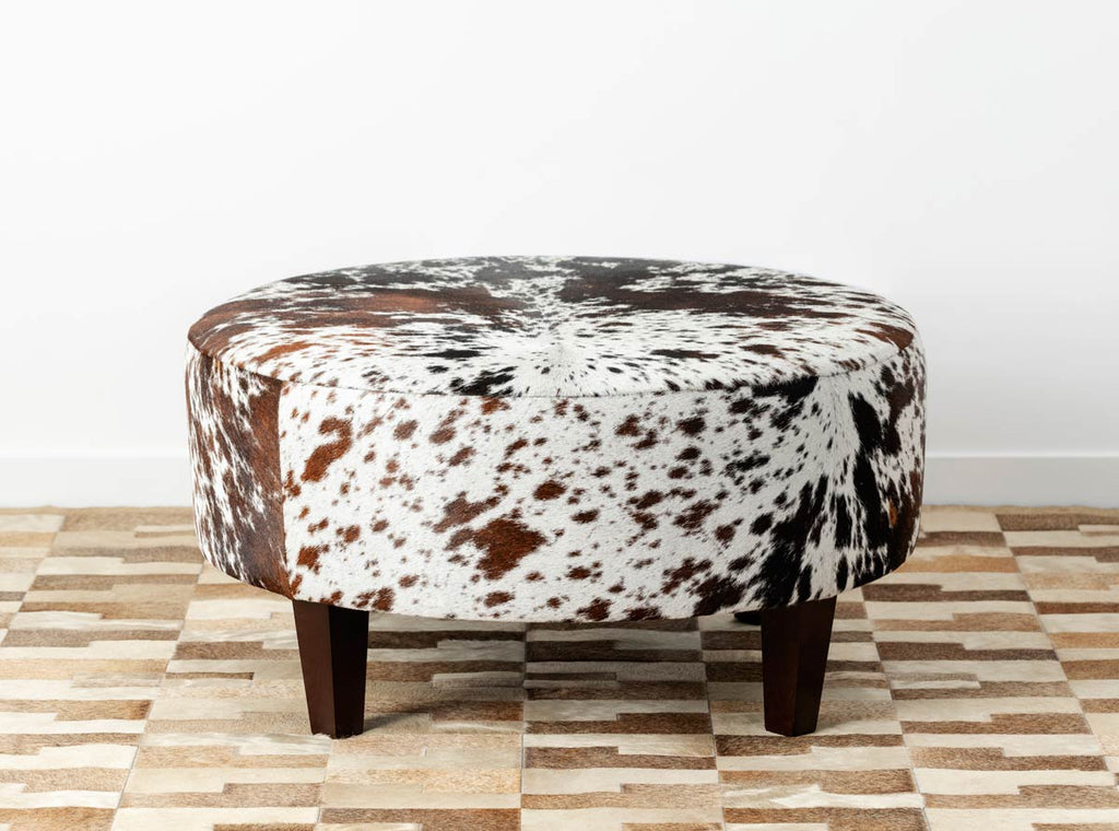 Speckled round cowhide ottoman with square legs