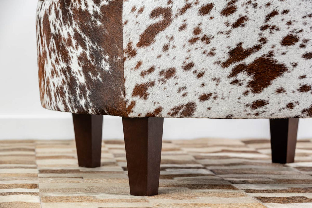 Round cowhide ottoman with square legs