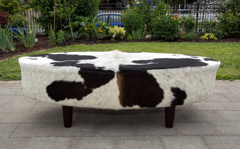Image of Brown and white oval cowhide ottoman by Gorgeous Creatures