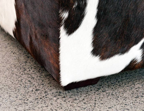 Image of Cowhide Ottoman Deep with Low Wood Legs 114x92x38cm